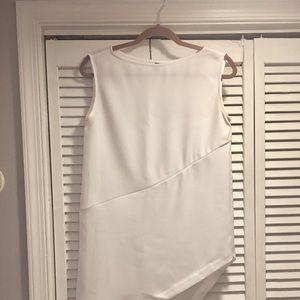 White asymmetrical hem tunic top